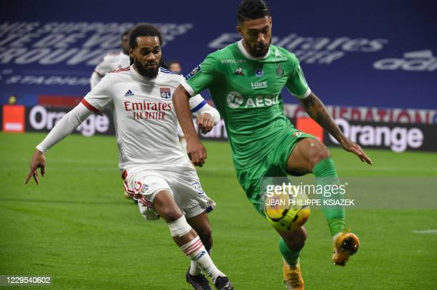 Lyon's Belgian defender Jason Denayer fights for the ball withSaintEtienne's Gabonese forward Denis Bouanga during the French L1 football match...