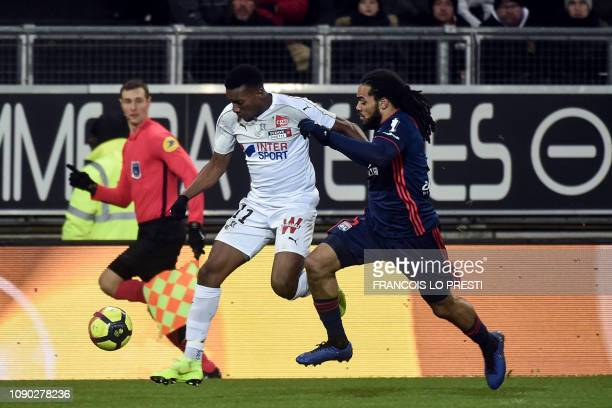 Lyon's Belgian defender Jason Denayer fights for the ball with Amiens' Colombian forward Juan Otero during the French L1 football match between...