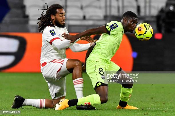 Lyon's Belgian defender Jason Denayer fights for the ball with Dijon's French midfielder Eric Junior Dina-Ebimbe during the French L1 footall match...