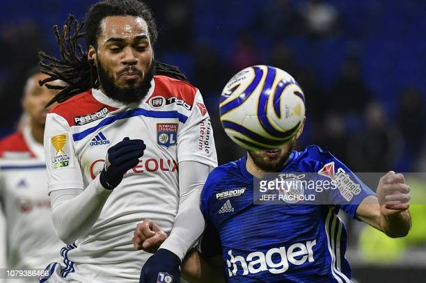 Lyon's Belgian defender Jason Denayer fights for the ball with Strasbourg's French midfielder Adrien Thomasson during the French League Cup quarter...