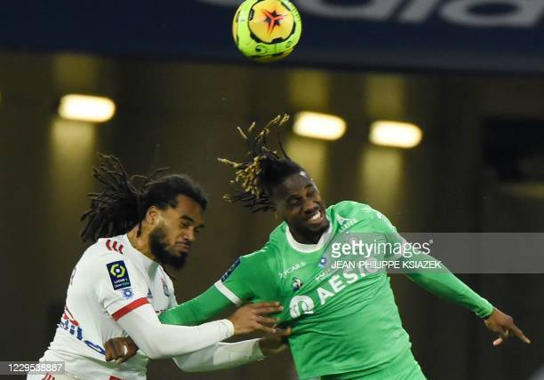Lyon's Belgian defender Jason Denayer fights for the ball with SaintEtienne's French forward Charles Abi during the French L1 football match between...