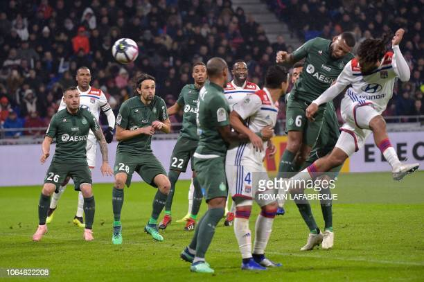 Lyon's Belgian defender Jason Denayer heads the ball and scores a goal during the French L1 football match between Lyon and SaintEtienne on November...