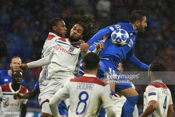 Lyon's Belgian defender Jason Denayer heads the ball with Hoffenheim's Algerian forward Ishak Belfodil during the UEFA Champions League Group F...