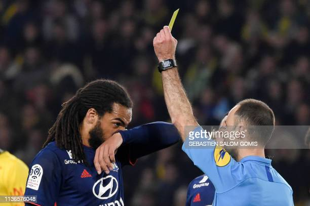 Lyon's Belgian defender Jason Denayer is shown a yellow card during the French L1 football match between FC Nantes and Olympique Lyonnais at the La...