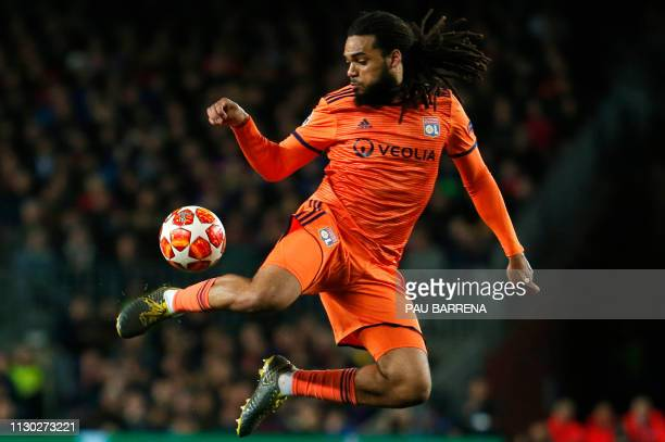 Lyon's Belgian defender Jason Denayer jumps for the ball during the UEFA Champions League round of 16, second leg football match between FC Barcelona...