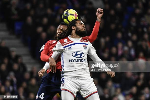 Lyon's Belgian defender Jason Denayer vies with Lille's Brazilian defender Gabriel Magalhaes during the French L1 football match between Olympique...