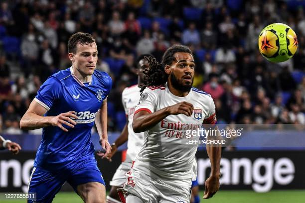 Lyon's Belgian defender Jason Denayer vies with Rangers FC's English defender George Edmundson during the French Lyon friendly tournament football...