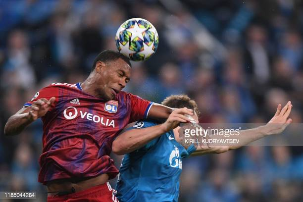Lyon's Brazilian defender Marcelo and Zenit St. Petersburg's Russian forward Artem Dzyuba vie for the ball during the UEFA Champions League group G...