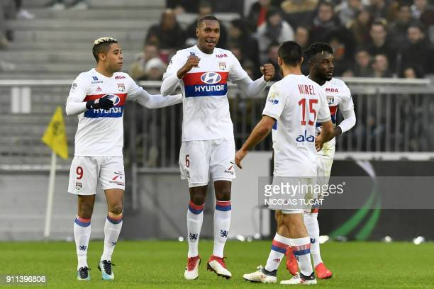 Lyon's Brazilian defender Marcelo celebrates with teammates after scoring a goal during the French Ligue 1 football match between Bordeaux and Lyon...