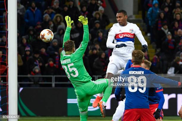 Lyon's Brazilian defender Marcelo scores a goal past CSKA Moscow's goalkeeper from Russia Igor Akinfeev during the UEFA Europa League round of 16...