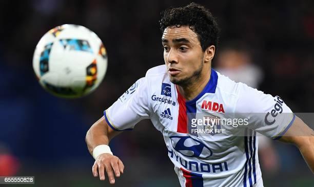 Lyon's Brazilian defender Rafael da Silva eyes the ball during the French L1 football match between Paris SaintGermain and Olympique Lyonnais at the...