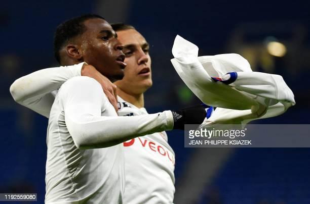 Lyon's Brazilian midfielder Jean Lucas celebrates after scoring a goal during the French League Cup quarterfinal football match between Olympique...