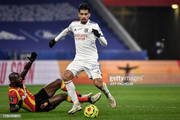 Lyon's Brazilian midfielder Lucas Paqueta challenges for the ball with Lens's French Ivorian midfielder Seko Fofana during the French L1 football...