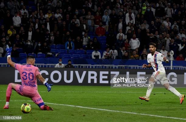 Lyon's Brazilian midfielder Lucas Paqueta scores a goal during the French L1 football match between Lyon and Troyes in Decines-Charpieu, on September...