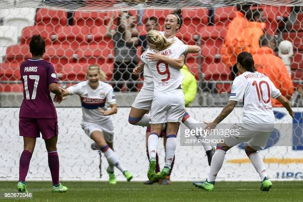Lyon's Bristish defender Lucy Bronze celebrates with her teamates after scoring a goal during the UEFA Women's Champions League semifinal second leg...