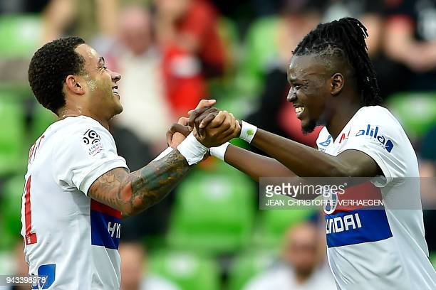 Lyon's Burkinabe forward Bertrand Traore and Lyon's Dutch forward Memphis Depay celebrate after scoring a goal during the French L1 football match...