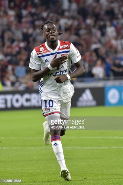 Lyon's Burkinabe forward Bertrand Traore celebrates after scoring a goal during the French L1 football match between Lyon and Marseille on September...