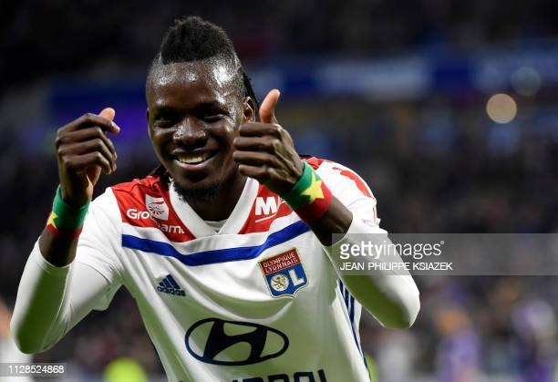 Lyon's Burkinabe forward Bertrand Traore celebrates after scoring a goal during the French L1 football match Lyon vs Toulouse on March 3 2019 at the...