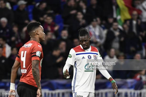 Lyon's Burkinabe forward Bertrand Traore celebrates after scoring a goal during the French Cup semi-final football match between Lyon and Rennes at...