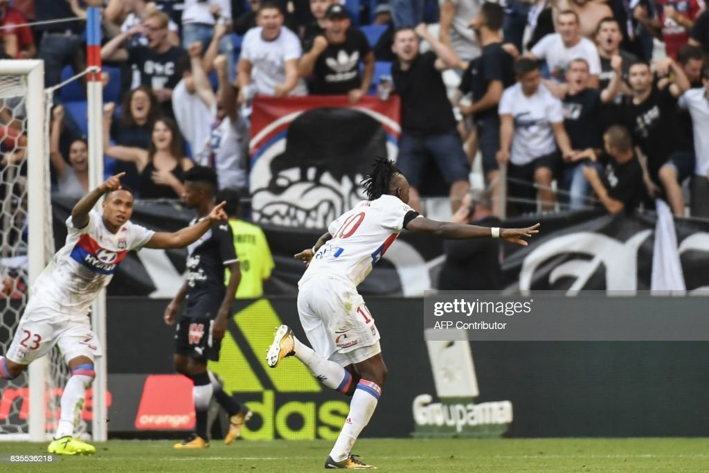 Lyon's Burkinabe forward Bertrand Traore (C) celebrates after scoring a goal during the L1 football match Olympique Lyonnais (OL) vs FC Girondins de Bordeaux (FCGB), on August 19, 2017 at the Groupama stadium in Décines-Charpieu near Lyon, southeastern France. /