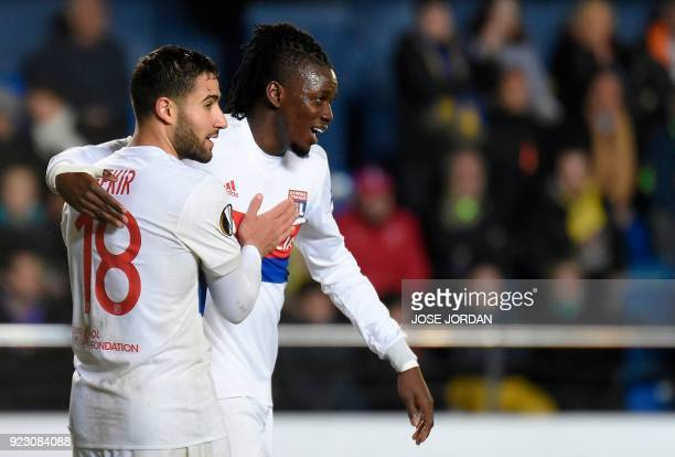 Lyon's Burkinabe forward Bertrand Traore celebrates with Lyon's French midfielder Nabil Fekir after scoring during the Europa League Round of 32...