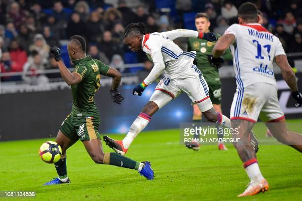 Lyon's Burkinabe forward Bertrand Traore shoots and scores a goal during the French L1 football match between Lyon and Reims on January 11 at the...