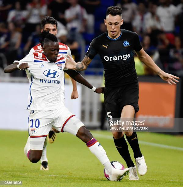 Lyon's Burkinabe forward Bertrand Traore vies with Marseille's Argentinian forward Lucas Ocampos during the French L1 football match between Lyon and...