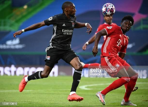 Lyon's Cameroonian forward Karl Toko Ekambi challenges Bayern Munich's Canadian midfielder Alphonso Davies during the UEFA Champions League semifinal...