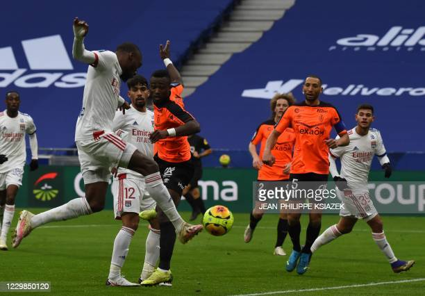 Lyon's Cameroonian forward Toko Ekambi aims at goal to score during the French L1 football match between Lyon and Reims on November 29 2020 at the...