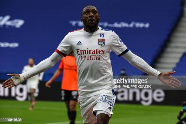 Lyon's Cameroonian forward Toko Ekambi celebrates after scoring a goal during the French L1 football match between Lyon and Reims on November 29 2020...