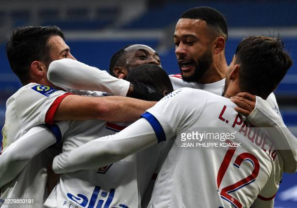 Lyon's Cameroonian forward Toko Ekambi celebrates with team mates after scoring a goal during the French L1 football match between Lyon and Reims on...