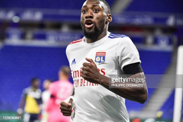 Lyon's Camerounese forward Karl Toko Ekambi celebrates after scoring a goal during the French L1 football match between Olympique Lyonnais and AS...