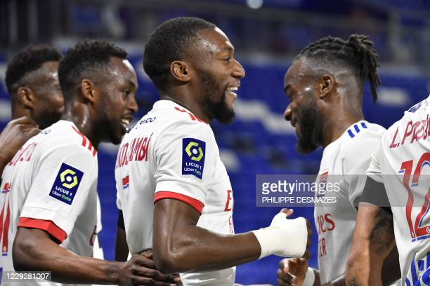Lyon's Camerounese forward Karl Toko Ekambi is congratuled by teamates after scoring a goal during the French L1 football match between Olympique...