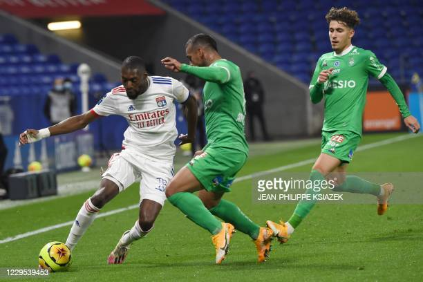 Lyon's Camerounian forward Toko Ekambi fights for the ball withSaintEtienne's Peruvian defender Miguel Trauco during the French L1 football match...
