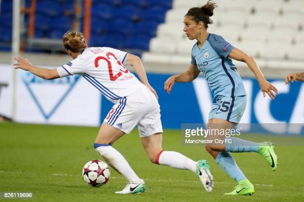 Lyon's Camille Abily and Manchester City's Carli Lloyd battle for the ball