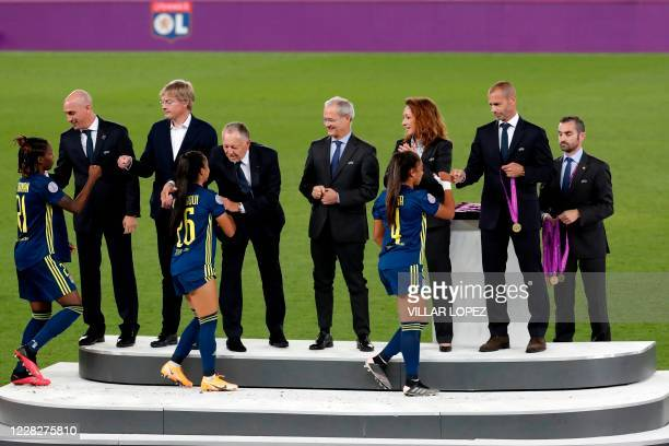Lyon's Canadian defender Kadeisha Buchanan Lyon's French defender Sakina Karchaoui and Lyon's French defender Selma Bacha get their winner's medal...