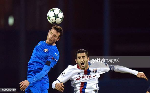 Lyon's defender Maxime Gonalons vies with Dinamo's forward Angelo Henriquez during the UEFA Champions League Group H football match between GNK...
