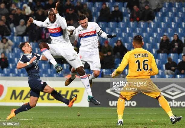 Lyon's defender Mouctar Diakhaby and Lyon's French midfielder Jordan Ferri vies with Montpellier's French goalkeeper Dimitry Bertaud during the...