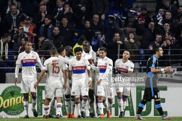 Lyon's defender Mouctar Diakhaby celebrates with his teamates after scoring during the UEFA Europa League football match Olympique Lyonnais vs...