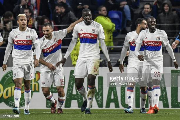 Lyon's defender Mouctar Diakhaby celebrates with his teammates after scoring during the UEFA Europa League football match Olympique Lyonnais vs...