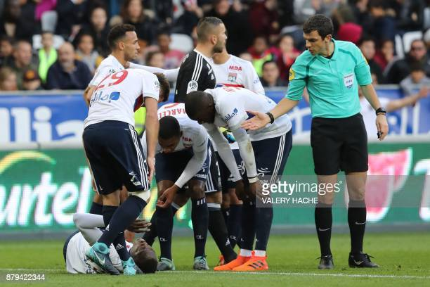 Lyon's defender Mouctar Diakhaby reacts after being injured during the French L1 football match Nice vs Lyon on november 26 2017 at the 'Allianz...