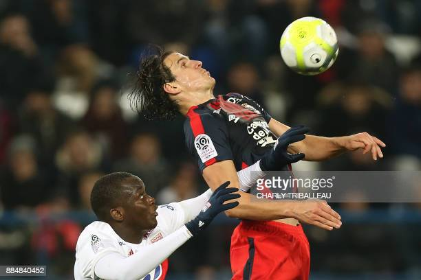 Lyon's defender Mouctar Diakhaby vies for the ball with Caen's Croatian forward Ivan Santini during the French L1 football match between Caen and...