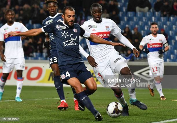Lyon's defender Mouctar Diakhaby vies with Montpellier's Brazilian defender Vitorino Hilton during the French League Cup round of 16 football match...