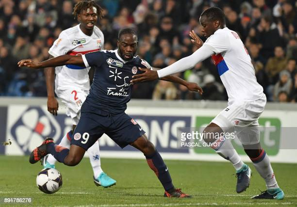 Lyon's defender Mouctar Diakhaby vies with Montpellier's French forward Jonathan Ikoné during the French League Cup round of 16 football match...