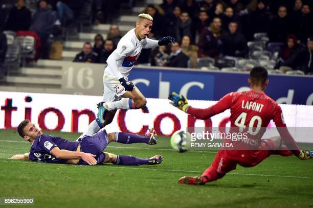Lyon's Dominican forward Mariano Diaz kicks the ball as Toulouse's French goalkepper Alban Lafont dives during the French L1 football match between...