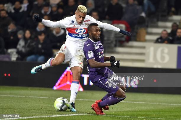 Lyon's Dominican forward Mariano Diaz vies for the ball with Toulouse's Burkinabe defender Steeve Yago during the French L1 football match between...