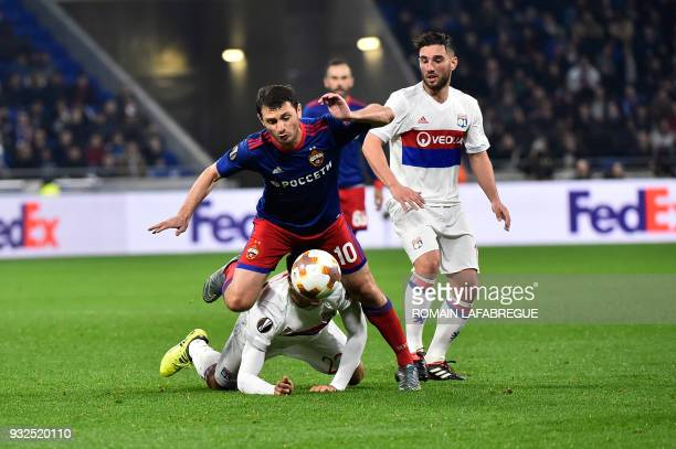 Lyon's Dutch defender Kenny Tete is challenged by Moscow's Russian midfielder Alan Dzagoev during the Europa League football match Olympique Lyonnais...