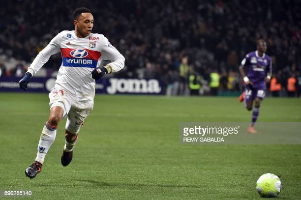 Lyon's Dutch defender Kenny Tete runs with the ball during the French L1 football match between Toulouse and Lyon on December 20 at the Municipal...