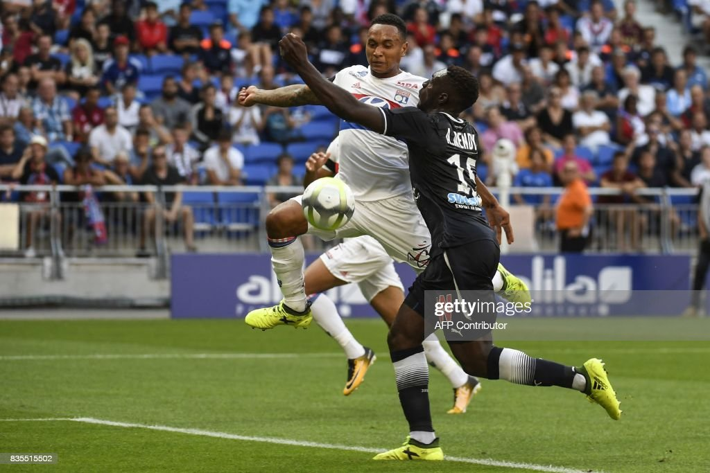 Lyon's Dutch defender Kenny Tete (L) shoots and scores during the L1 football match Olympique Lyonnais (OL) vs FC Girondins de Bordeaux (FCGB), on August 19, 2017 at the Groupama stadium in Décines-Charpieu near Lyon, southeastern France. /