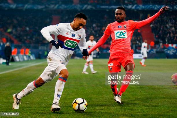 Lyon's Dutch defender Kenny Tete vies for the ball with Caen's Congolese defender Durel Avounou during the French Cup quarter-final football match...